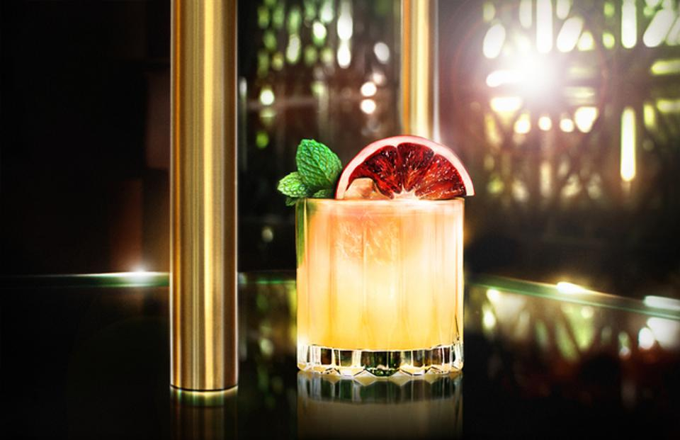 A gold sunset cocktail, made with Clase Azul GOLD tequila.
