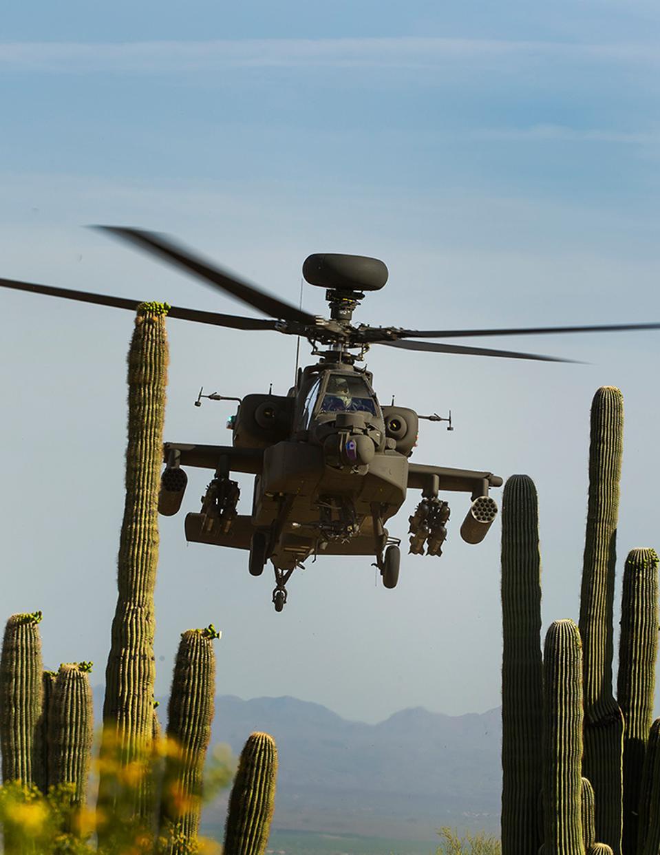 AH-64E down low over the desert.