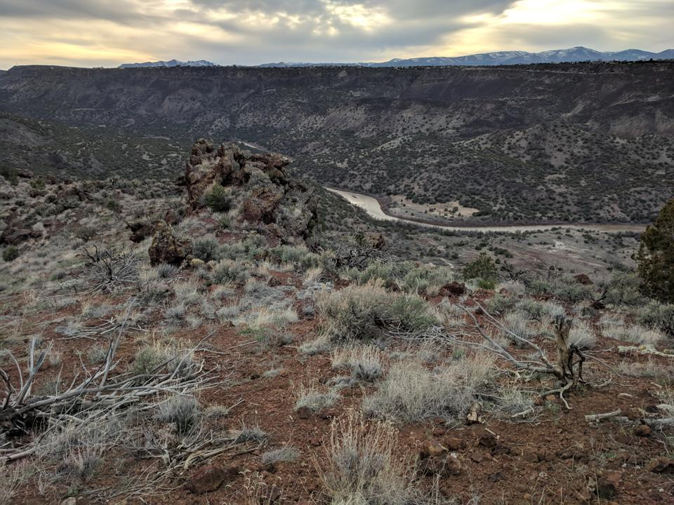 The Rio Grande winds below the Pajarito Plateau and the town of White Rock above.