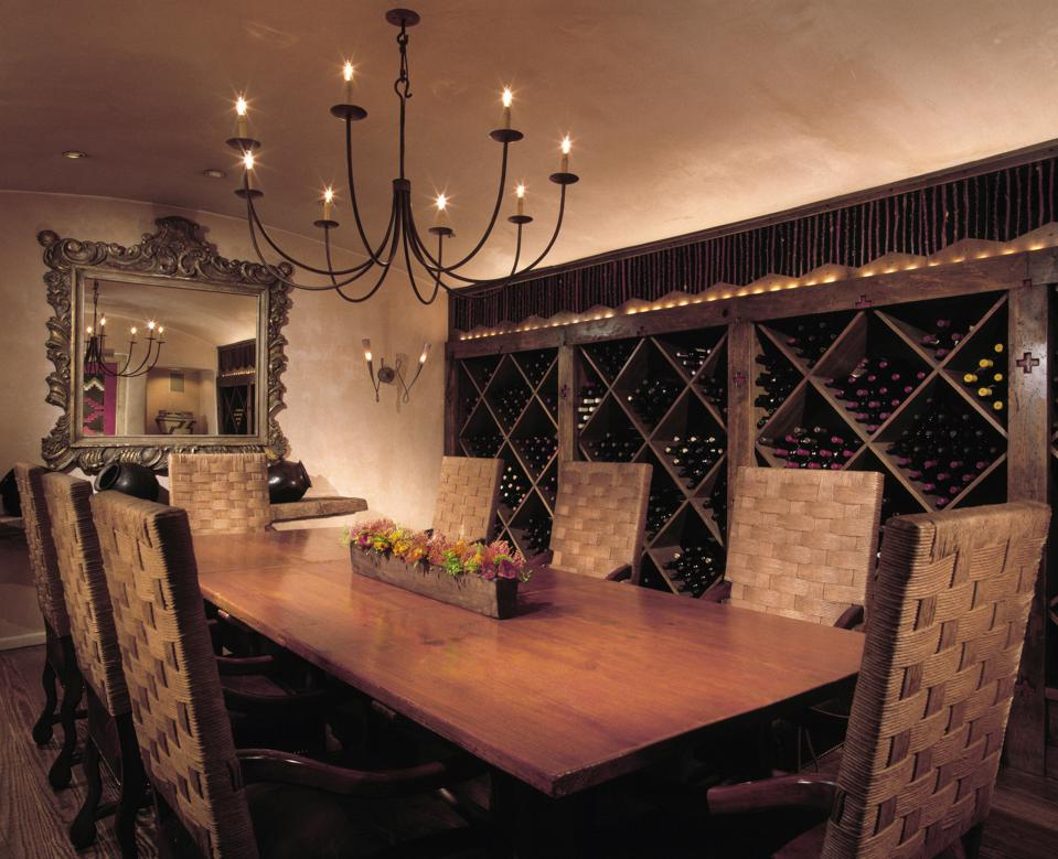A table and chairs within a wine cellar at the hotel Rosewood Inn of the Anasazi.