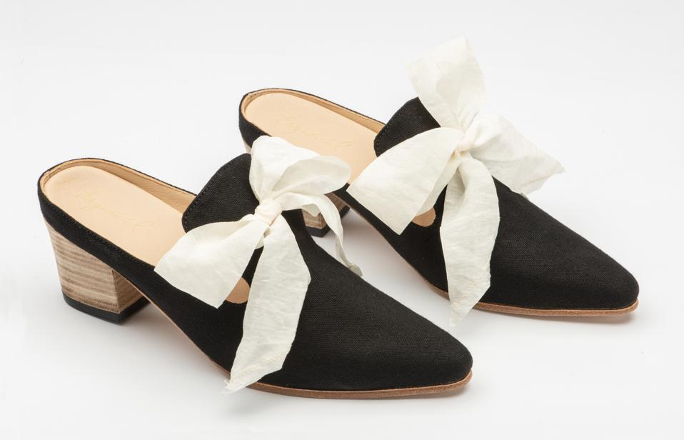Black luxury canvas slip on mule with removable washed silk bow and smooth leather lining