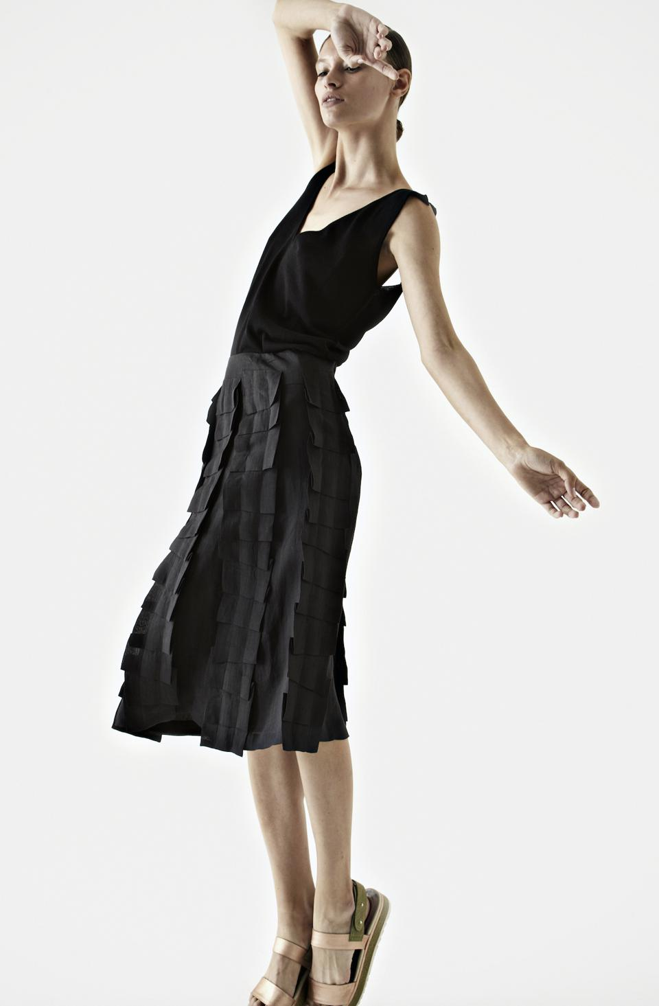 Finest quality 100% light linen skirt with origami applications; high gauge fine cotton top.