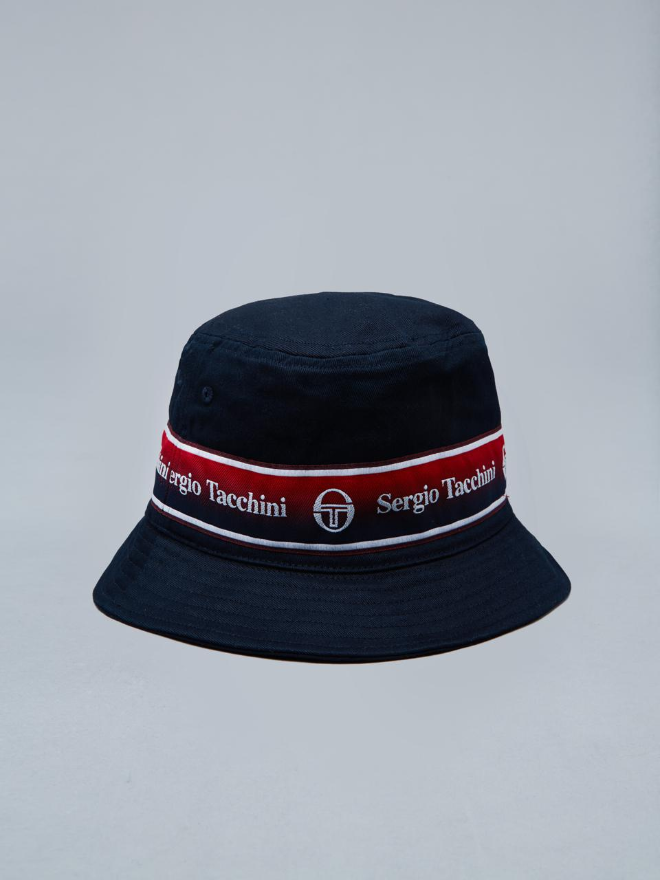 The Fivo Bucket Hat is a contemporary take on retro headwear, crafted from breathable cotton twill in a classic 360-degree brim silhouette for maximum sun protection. A wardrobe essential, the hat features Sergio Tacchini-branded taping around the brim seam for a throwback vibe, while embroidered eyelets offer additional ventilation.