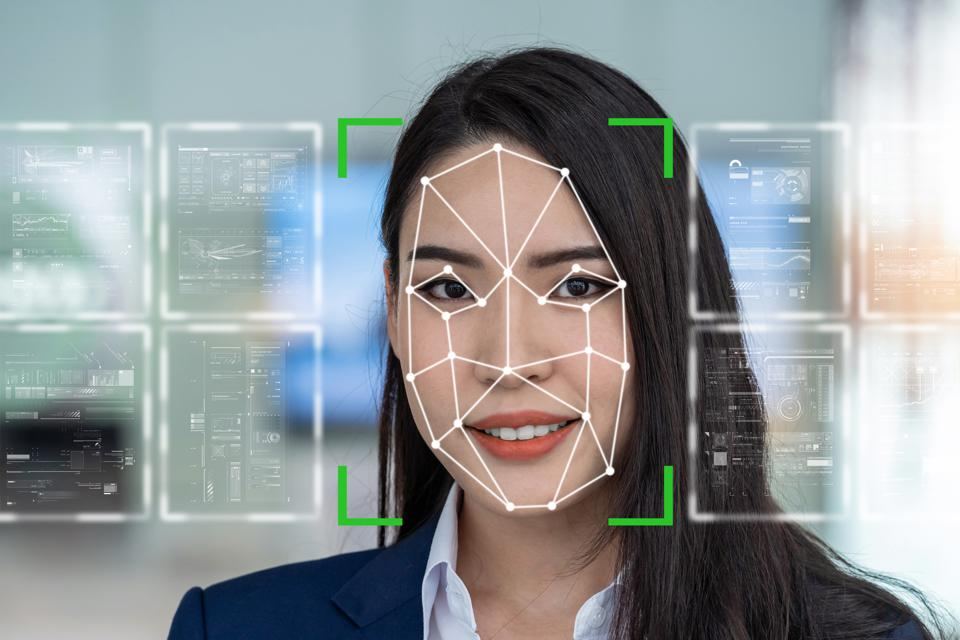 Asian women being futuristic vision by Face detection and recognition the various virtual screen tools