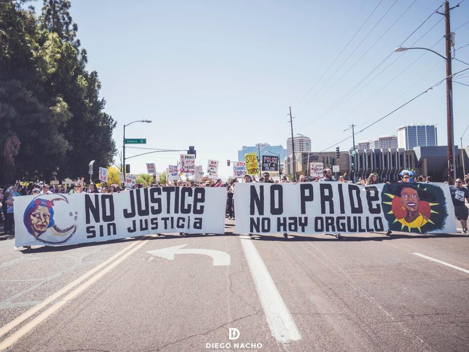 Members of Trans Queer Pueblo blocking the 2017 Phoenix Pride Parade