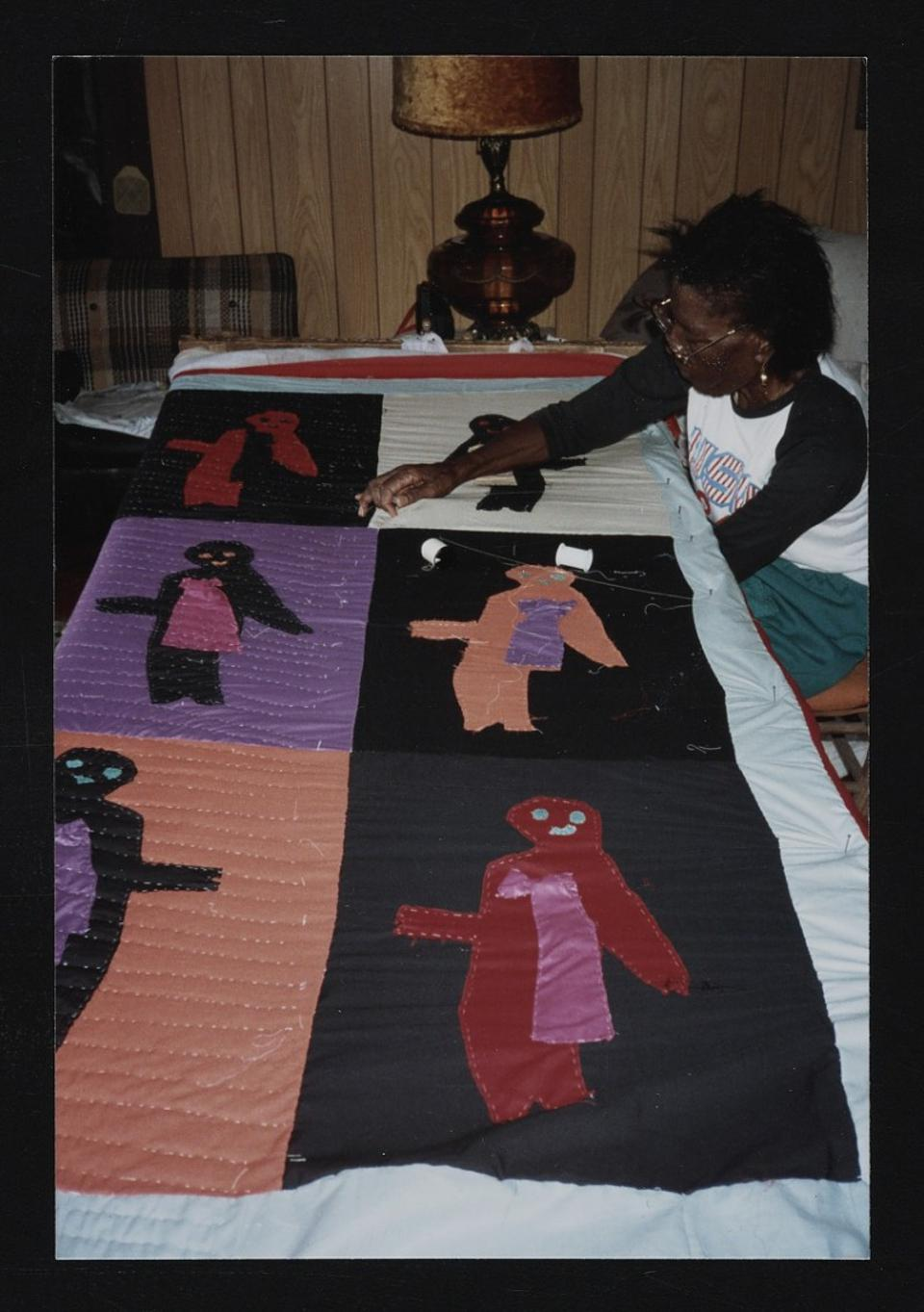 The artists Sarah Mary Taylor working on a quilt.