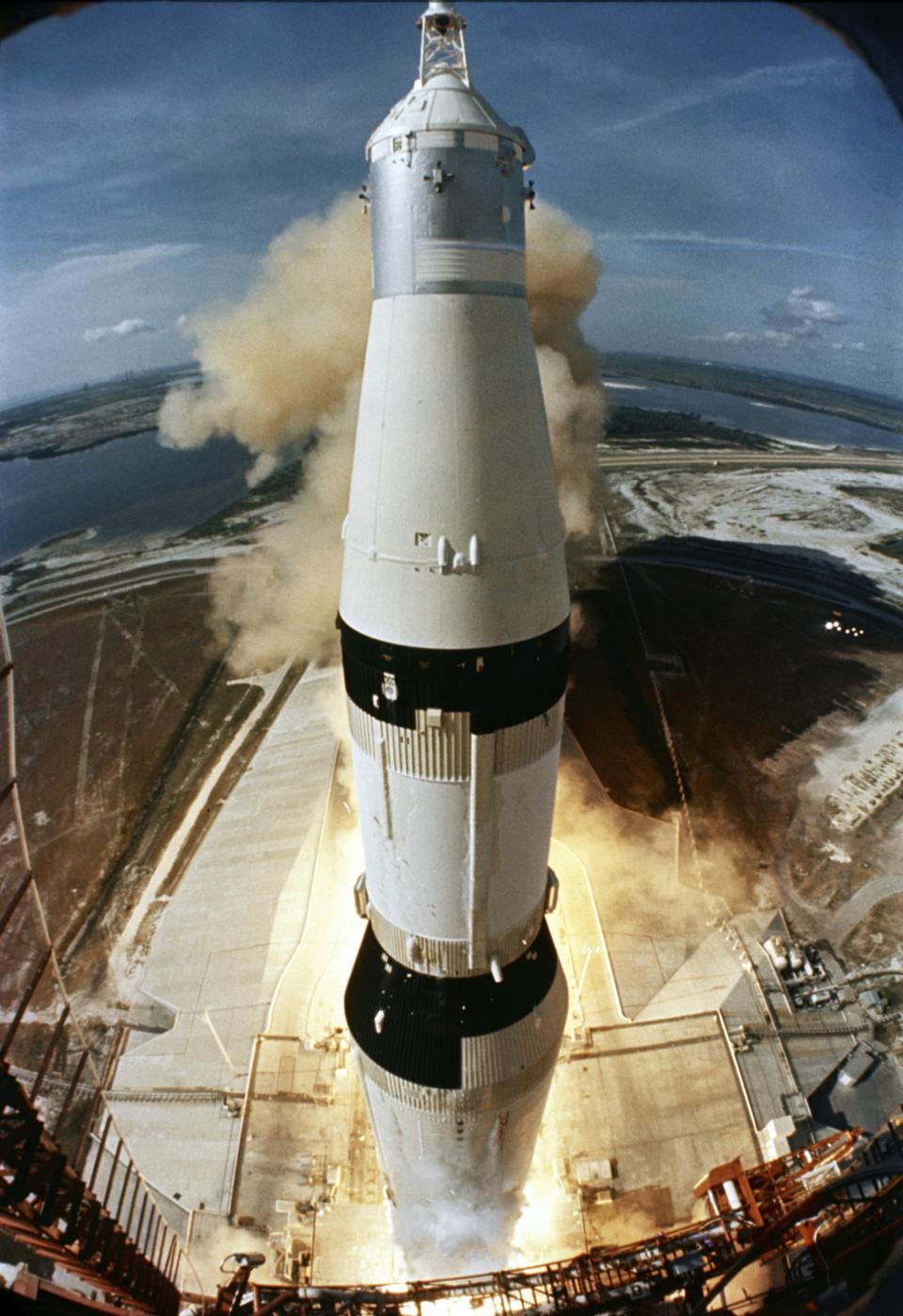 The liftoff of a Saturn V rocket on its way to the Moon.