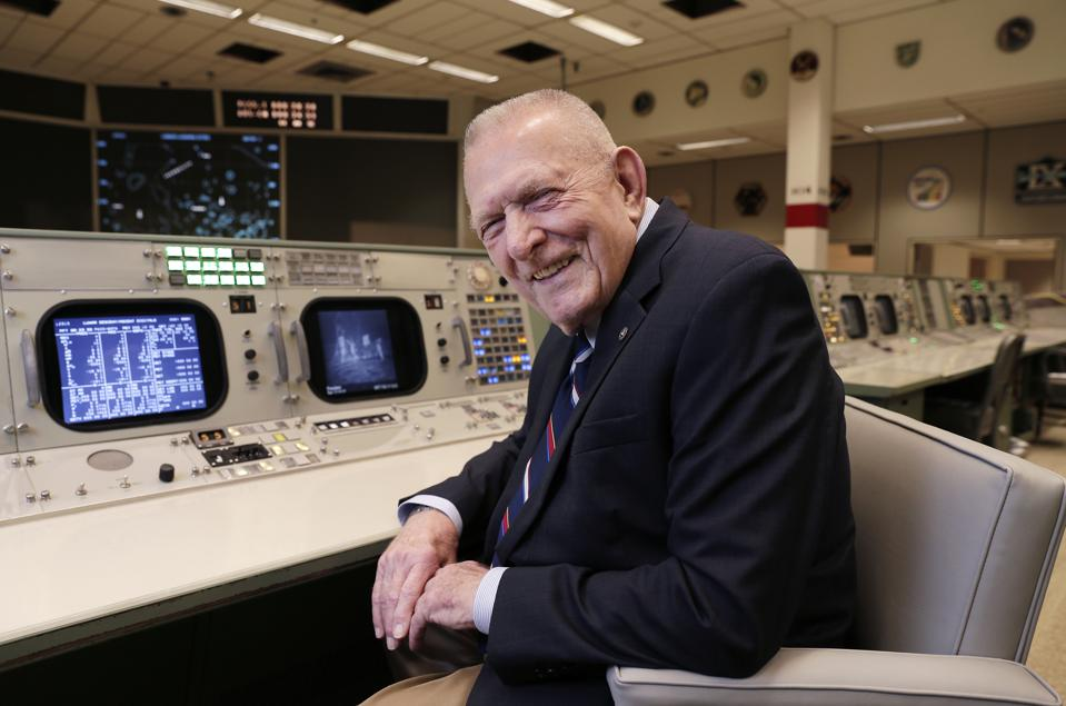 In this Monday, June 17, 2019 file photo, Gene Kranz, aerospace engineer, fighter pilot, an Apollo-era flight director and later director of NASA flight operations, sits at the console where he worked during the Gemini and Apollo missions at the NASA Johnson Space Center in Houston. Kranz says the makers of the 1995 ″Apollo 13″ film came up with the line ″Failure is not an option.″ Ask Kranz what he actually told flight controllers, he says, ″I have never lost an American in space, sure as hell aren't going to lose one now. This crew is coming home. You got to believe it. Your team must believe it. And we must make it happen.″ (AP Photo/Michael Wyke)