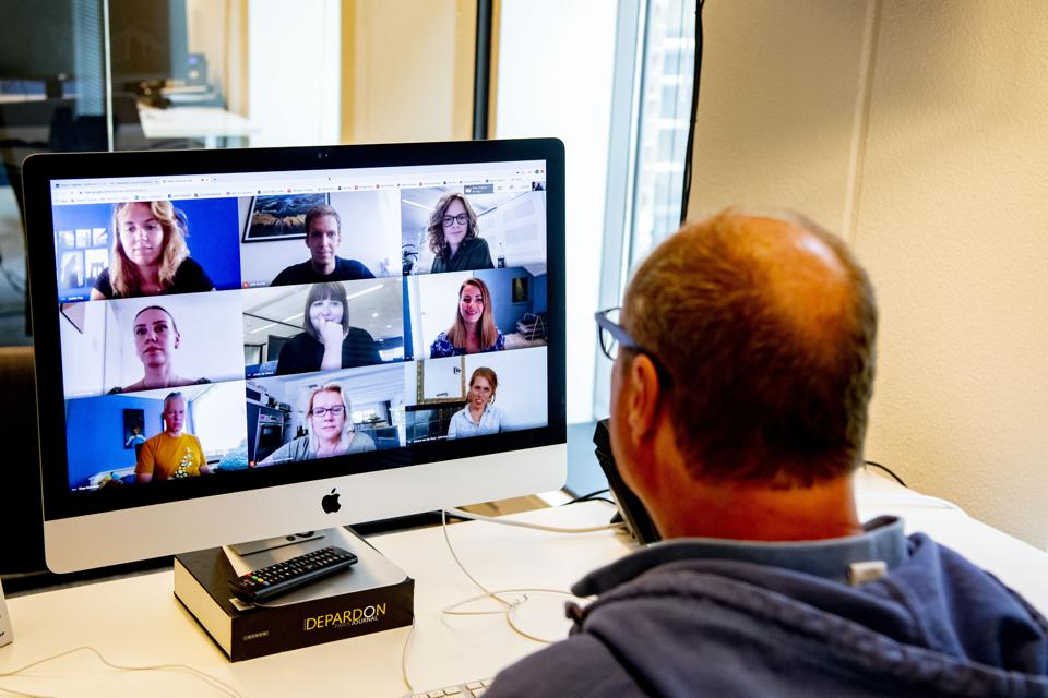 A director is seen having an online meeting with his...