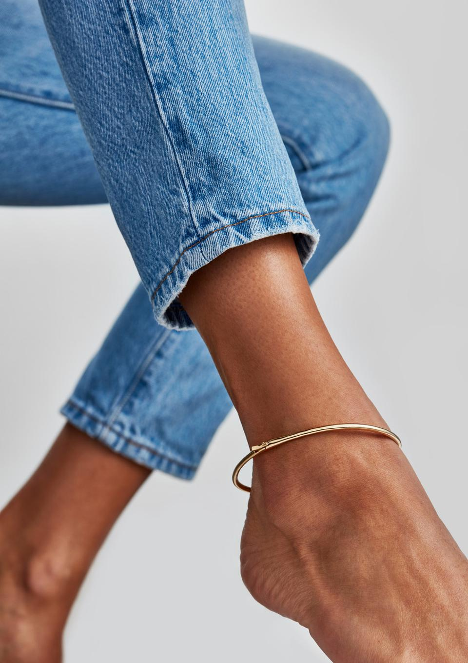 A bangle for your ankle. This structured oval anklet wraps around your ankle. Anklet opens and closes by custom fold-over hinge clasp. To open the anklet press down on the clip, ever so slightly. Dipped in 14k gold and finished in a high polish. $105