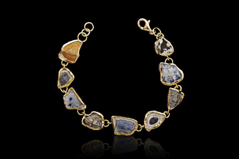 A bracelet featuring slices of Judean desert gemstones, set in 18kt gold, by Anna Ben Ruby.