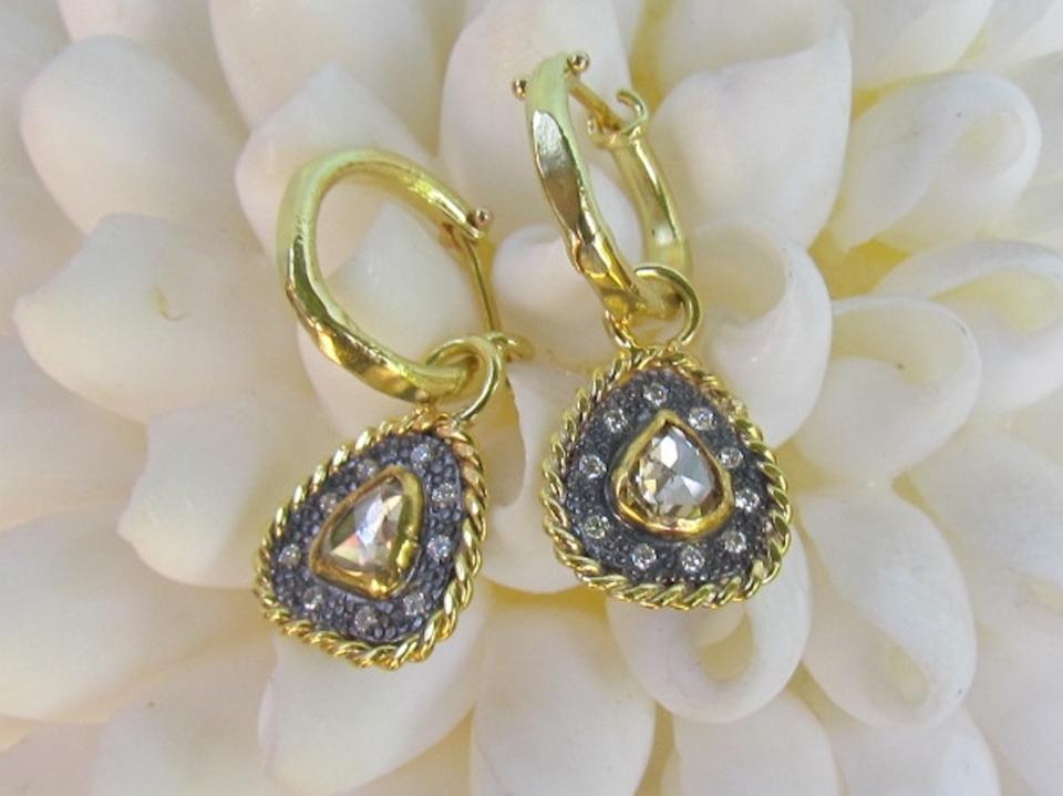 Diamond and 18kt gold earrings by Anna Ben Ruby.