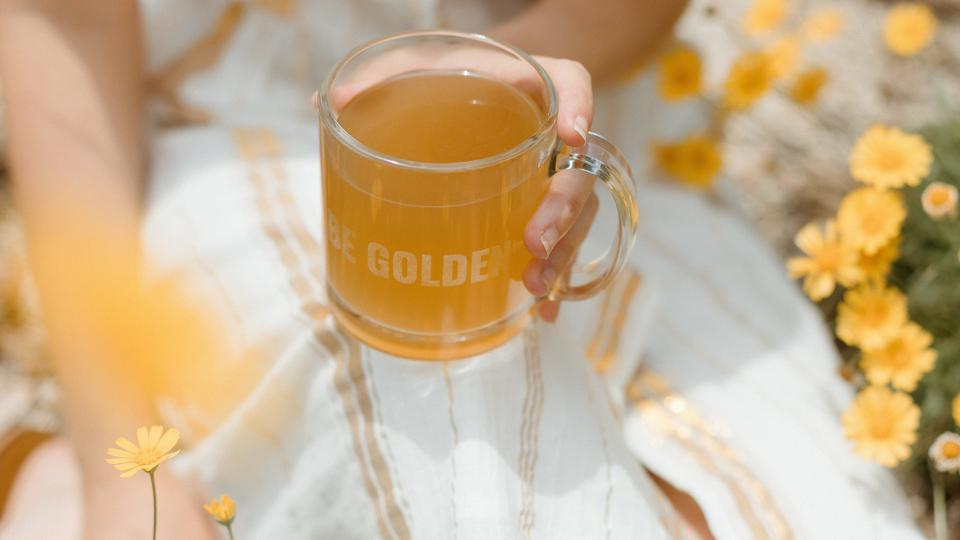 Golden Ratio coffee in cup with hand