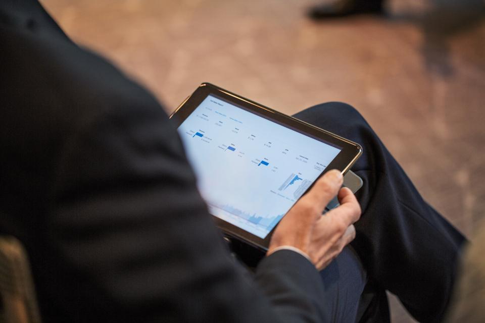 Businessman using a digital tablet during seminar