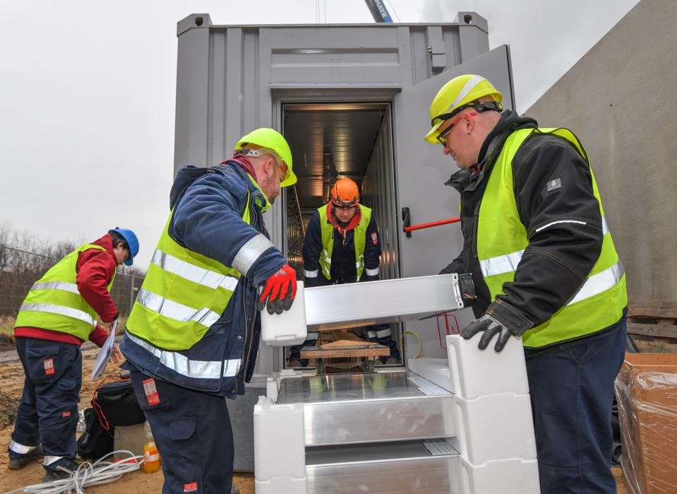 Workers putting together a lithium-ion battery facility in Lausitz, Germany.