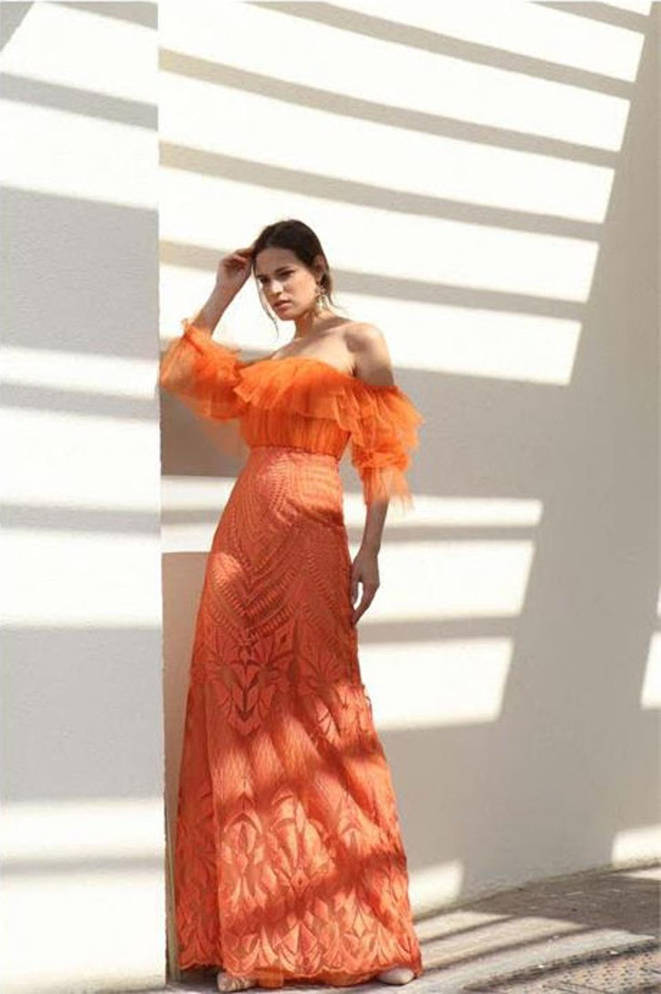 Off to the Races by THYM is the perfect addition to your summer evening wardrobe. This floor-length vibrant dress is cut from lace into a flattering A-line silhouette with a delicately draped, off-the-shoulder neckline and contrasting textures — an IT girl cocktail number for hot afternoons into sultry nights!