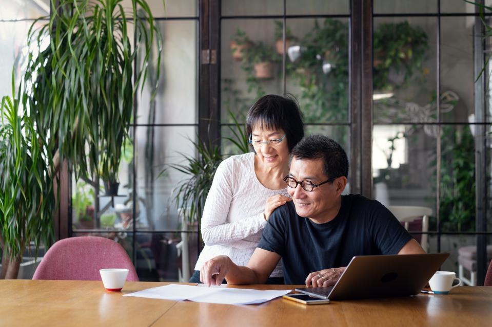 Senior couple talking about home finances