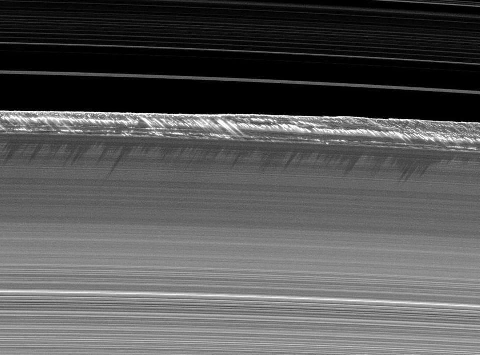 Saturn's rings in a nearly edge-on configuration, with the shadows cast by ice crystals.