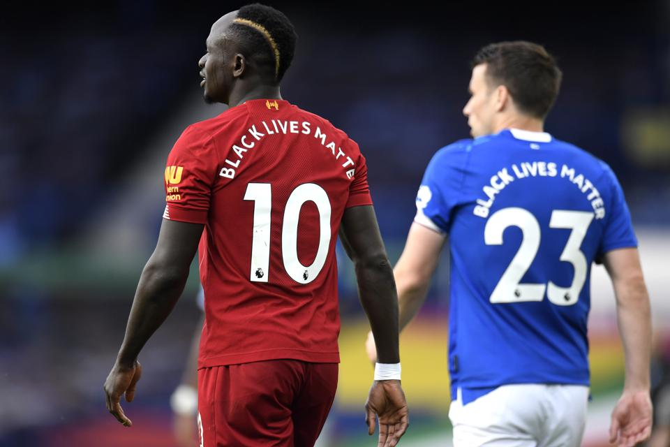 LIVERPOOL, ENGLAND - JUNE 21: Sadio Mane of Liverpool looks on as the Black Lives Matter movement slogan is seen on the back of his shirt during the Premier League match between Everton FC and Liverpool FC at Goodison Park on June 21, 2020 in Liverpool, England. Football Stadiums around Europe remain empty due to the Coronavirus Pandemic as Government social distancing laws prohibit fans inside venues resulting in all fixtures being played behind closed doors. (Photo by Peter Powell/Pool via Getty Images)