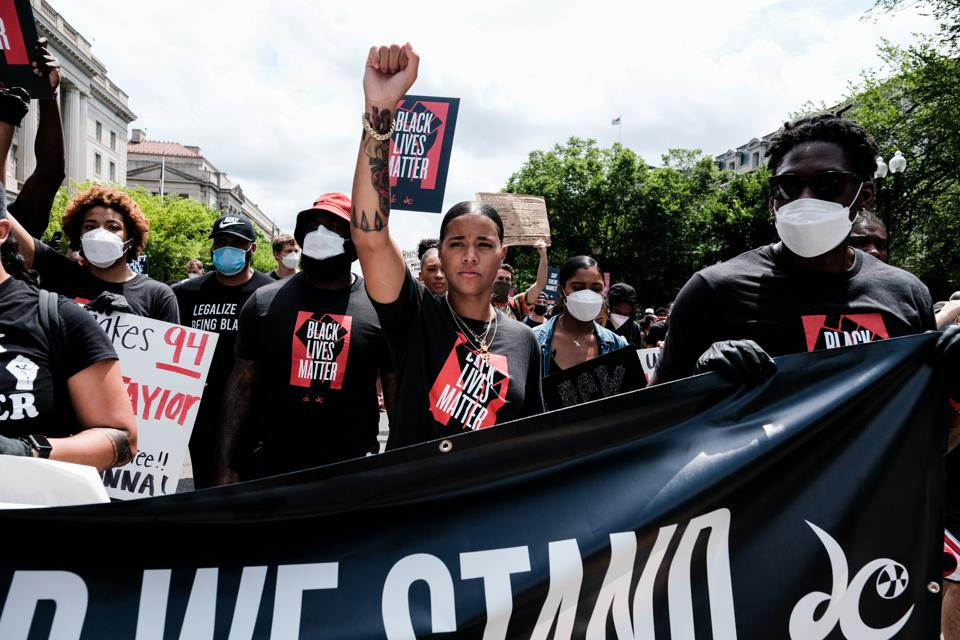 WASHINGTON, DC - JUNE 19: Natasha Cloud, of the Washington Mystics, marches to the MLK Memorial to support Black Lives Matter and to mark the liberation of slavery on June 19, 2020 in Washington, DC. (Photo by Michael A. McCoy/Getty Images)