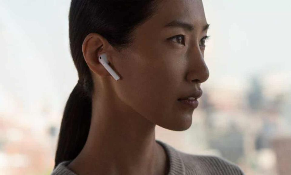 Promotional image showing the original AirPods in 2016.