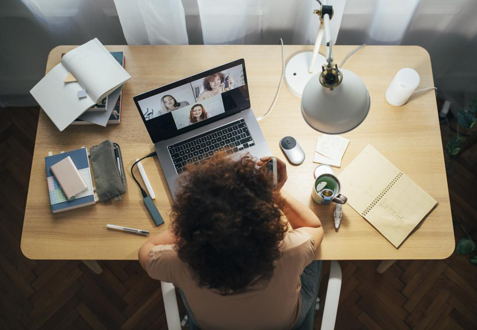 Social Distancing and Self Care: Happy Woman Teleconferencing from Home