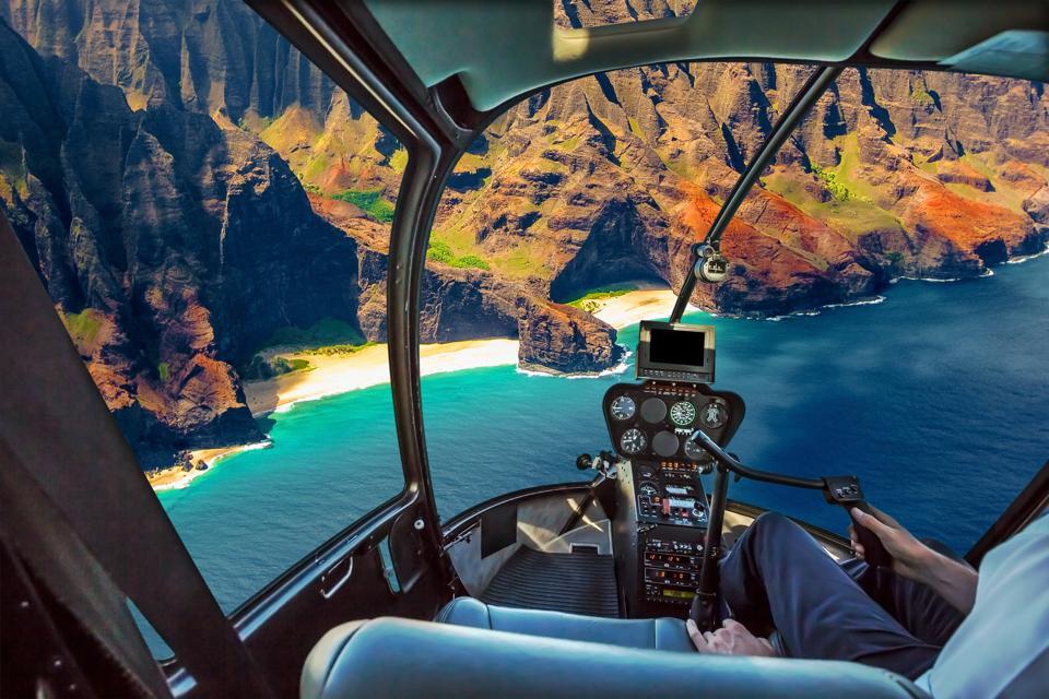 Helicopter flies in Na Pali coast, Kauai
