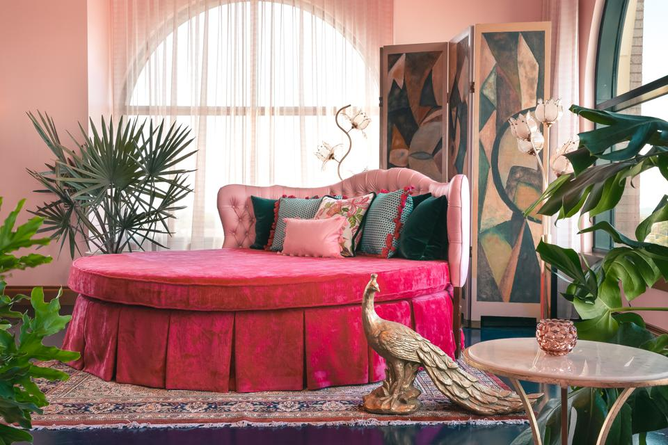 A pink bed and statue