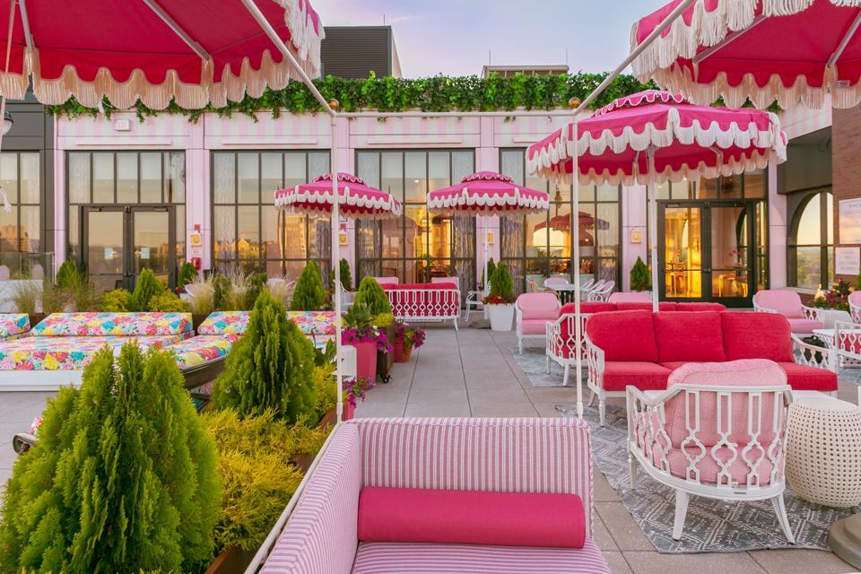 Pink umbrellas line a pool in Nashville