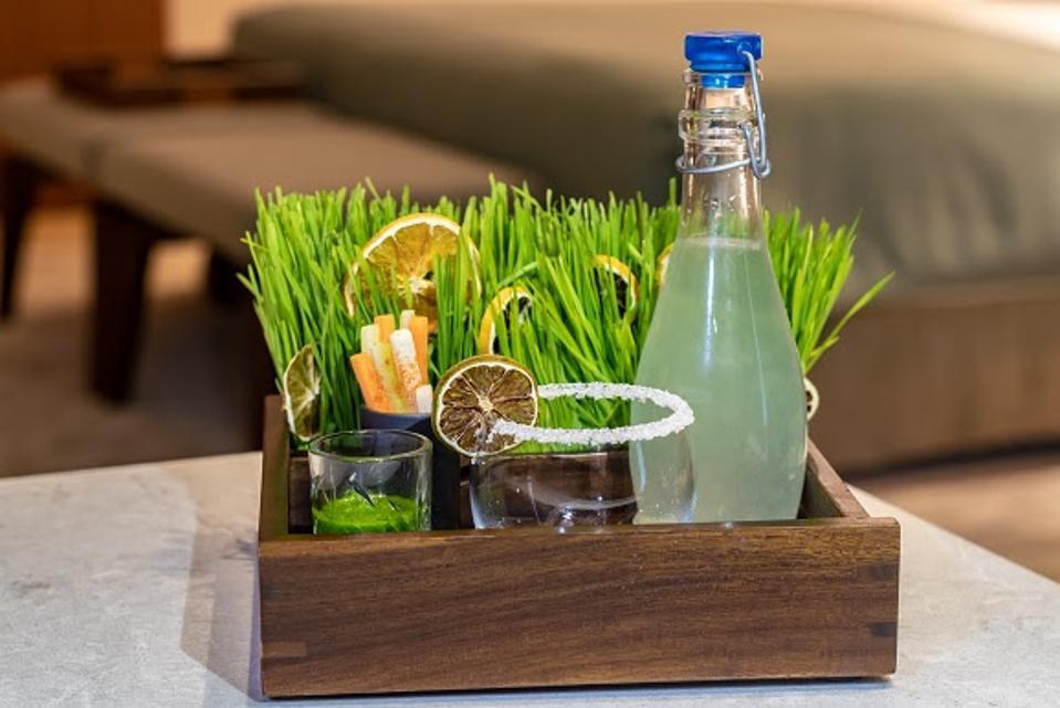 Wheatgrass margarita kit with bottle and salt rimmed glass.