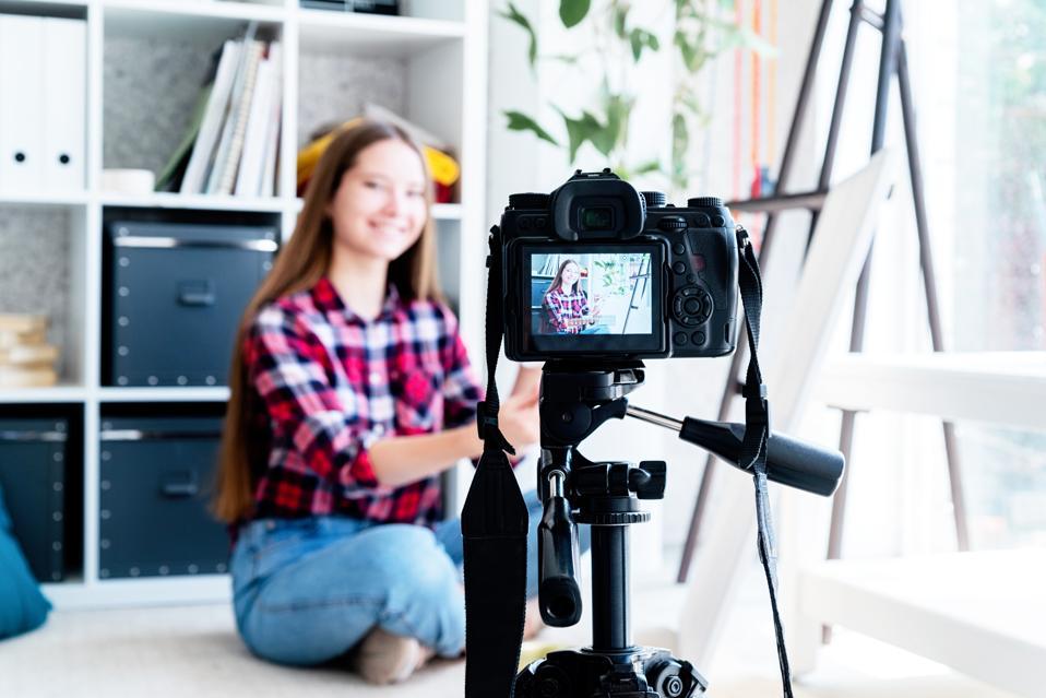Teenager girl artist making a video for her art blog
