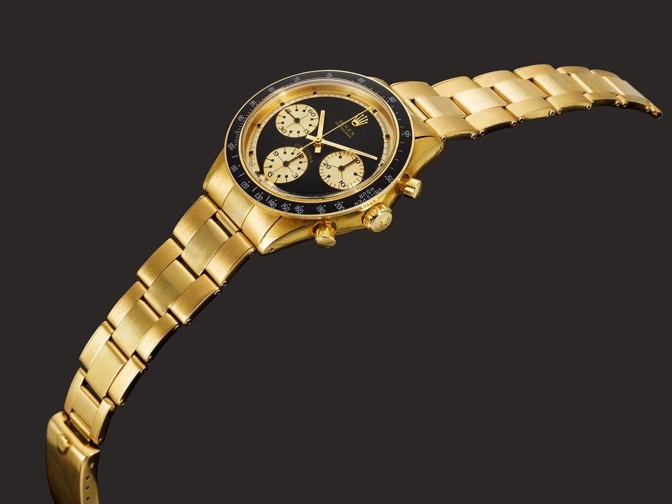 The Rolex Cosmograph Daytona JPS reference 6264 in 18k yellow gold