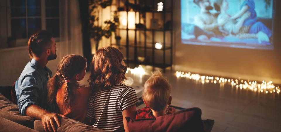 Family enjoying a movie at home