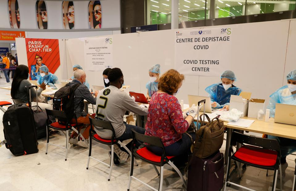 Passengers wearing masks face covid-19 tests at Paris Charles de Gaulle Airport France