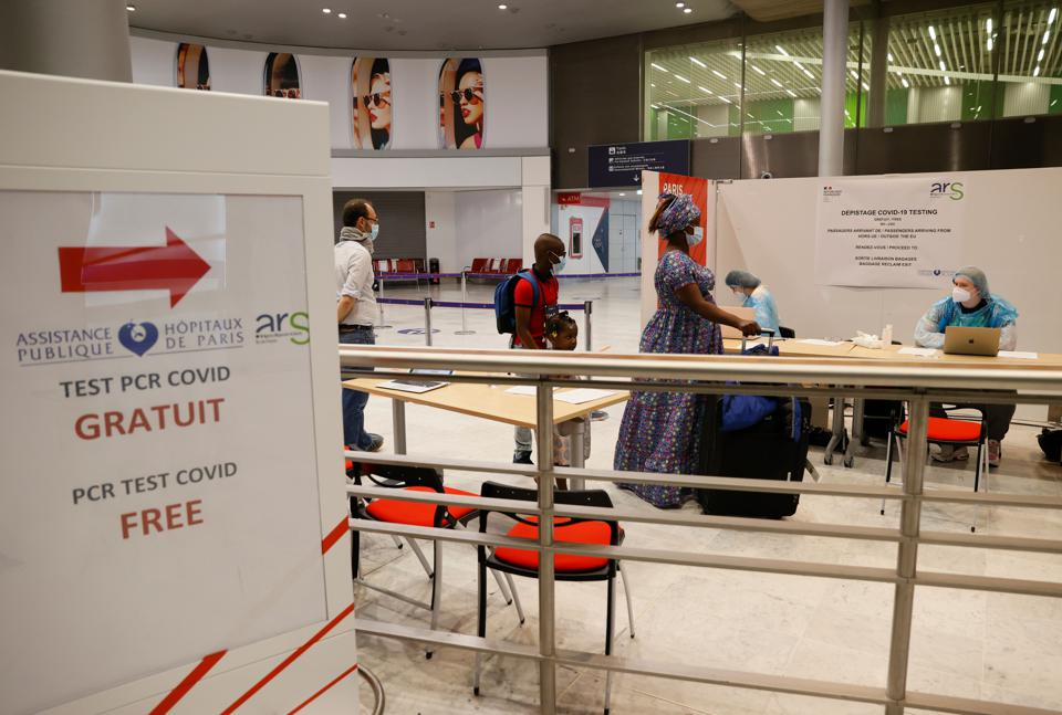 passengers line up for free covid tests Paris Charles de Gaulle airport