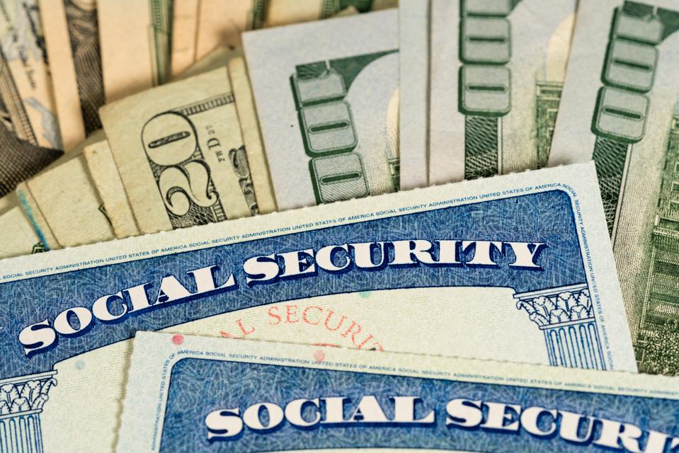 USA Social security cards laid on dollar bills