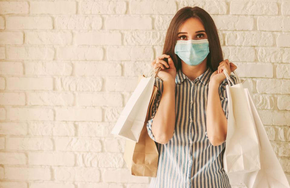Girl shopaholic with paper shopping bags