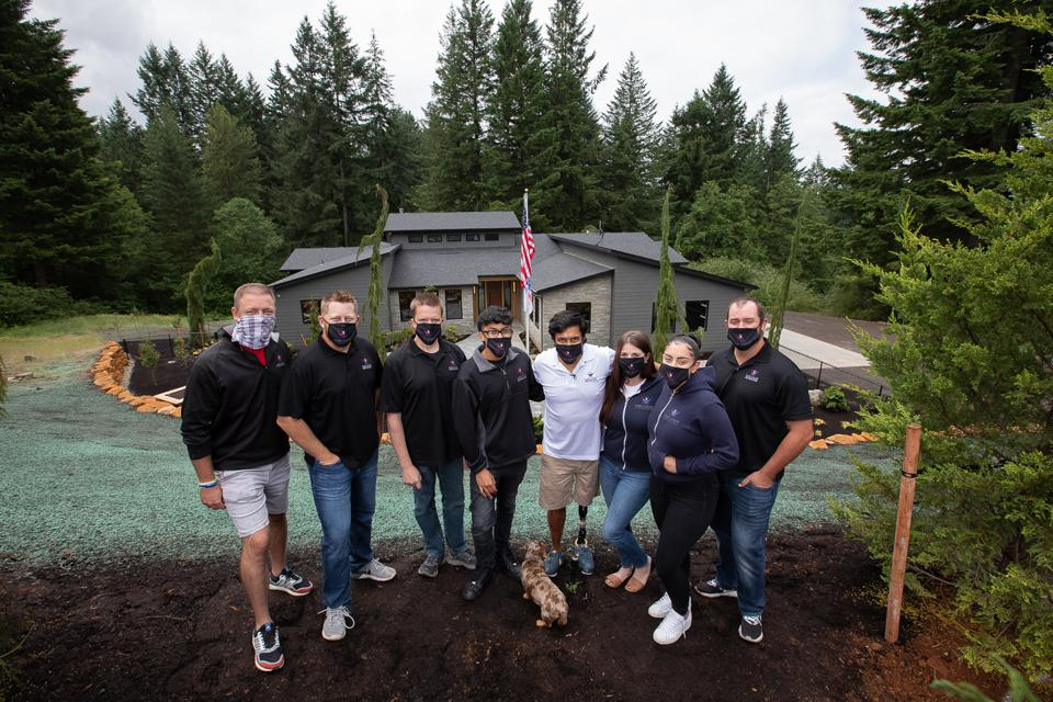 Gary Sinise Foundation's R.I.S.E. team welcomes a new veteran (center/white shirt) to his new accessible smart home.