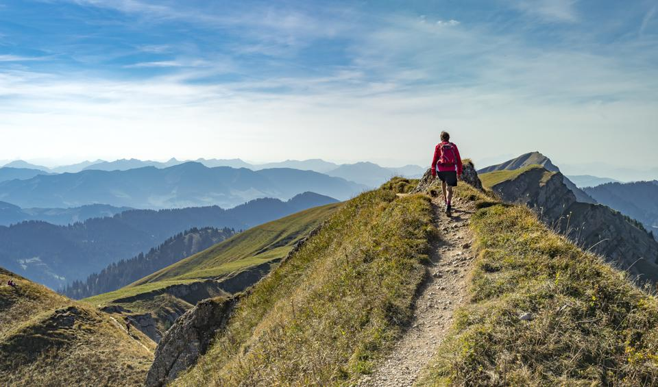 woman hiking in the Alps