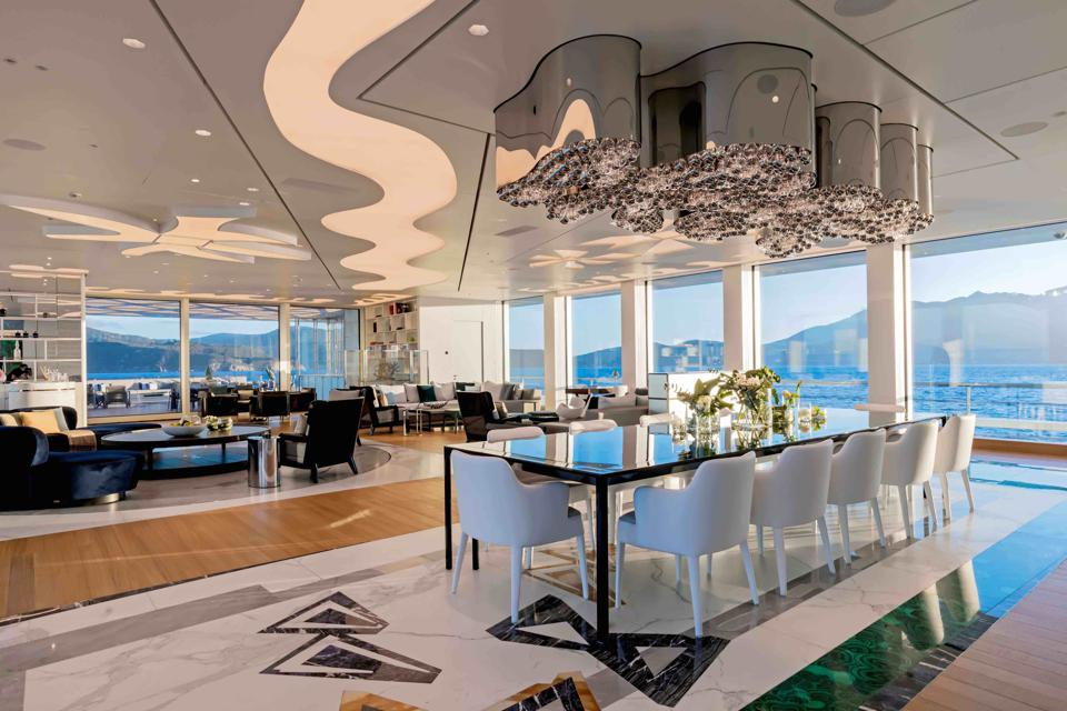 An octopus-shaped chandelier hangs over the dining table on the Luminosity superyacht