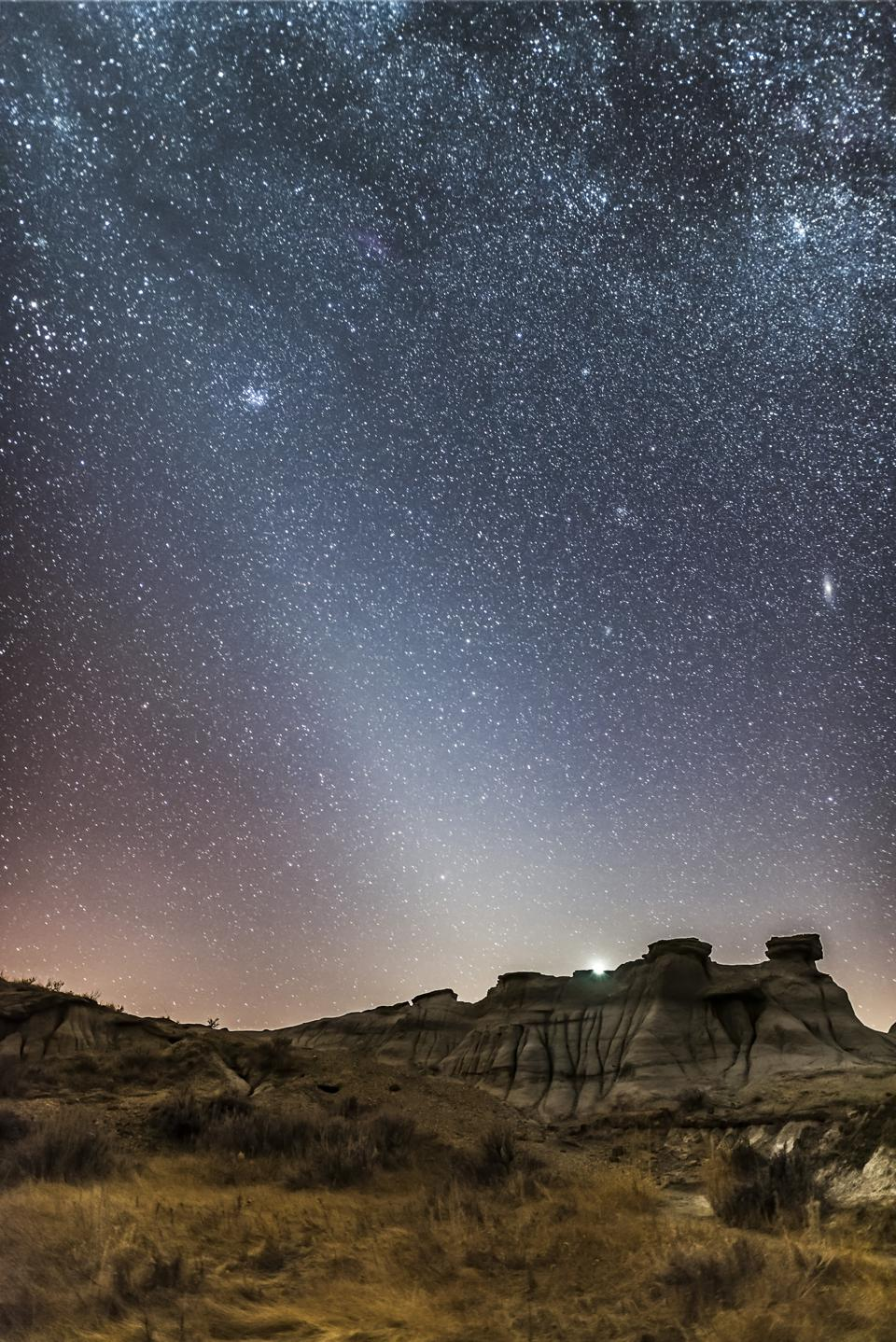 Sights like Zodiacal Light (the cone-shaped light) and the Andromeda Galaxy (center, right) are now impossible to see with the unaided eye from all but the darkest of places. (VW Pics/Universal Images Group via Getty Images)