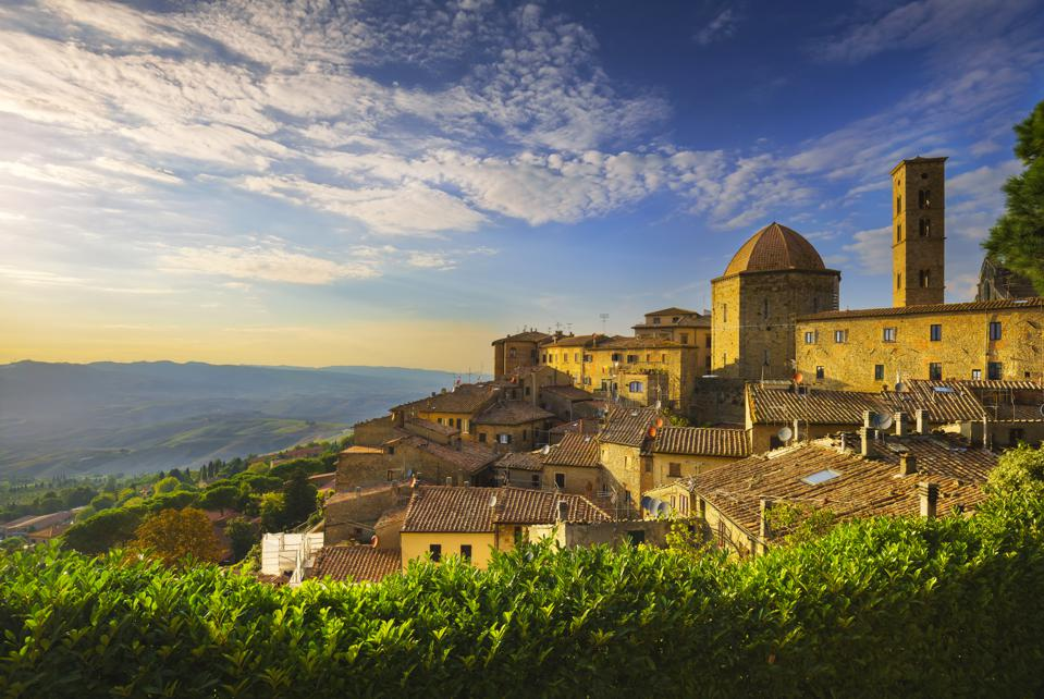 Tuscany, Volterra town skyline, church and panorama view during sunset