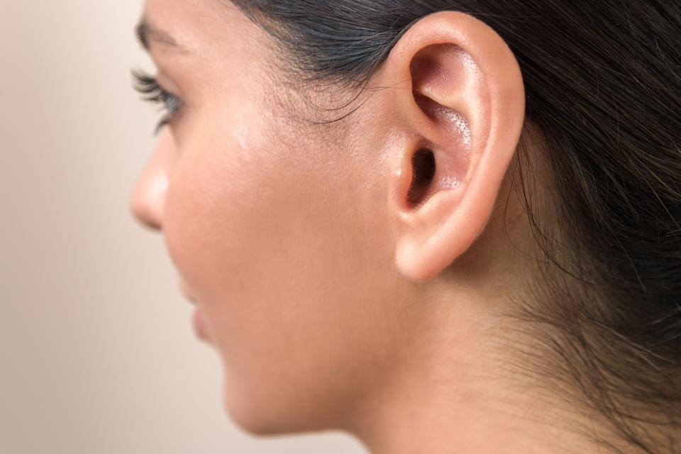 hearing problems. close up ear of a young woman. women hear everything Covid-19 coronavirus SARS-CoV2