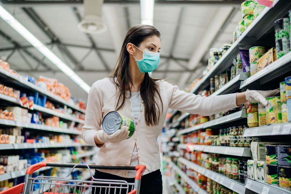 Woman shopping wearing mask.