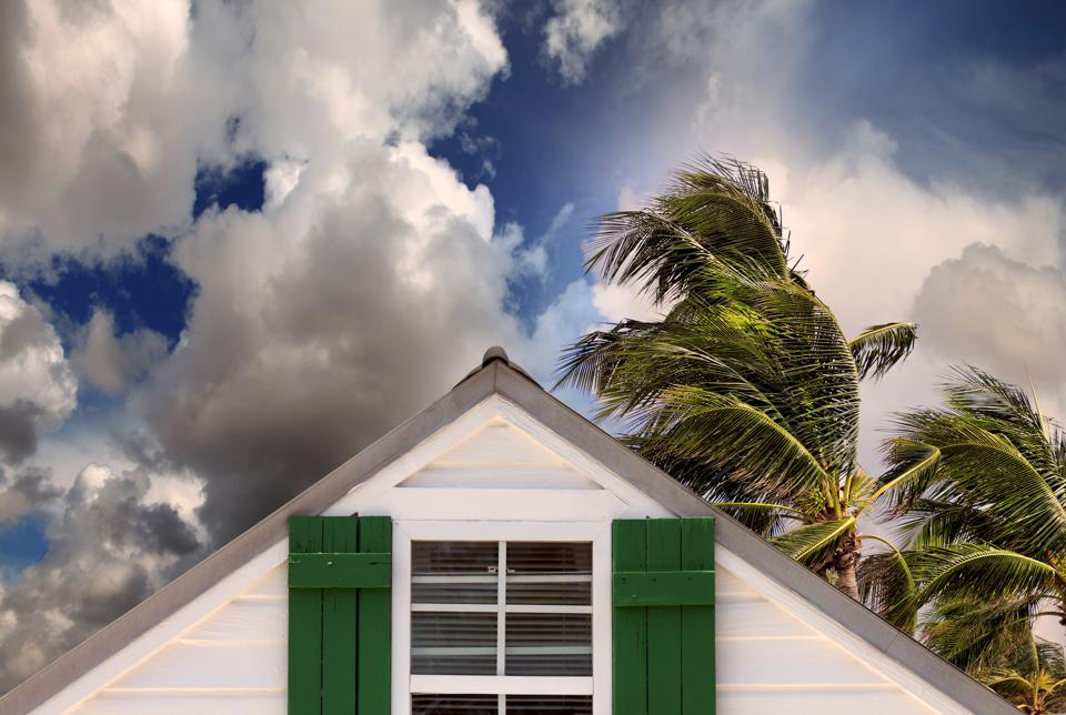 close up rooftop of a wooden house in tropical storm