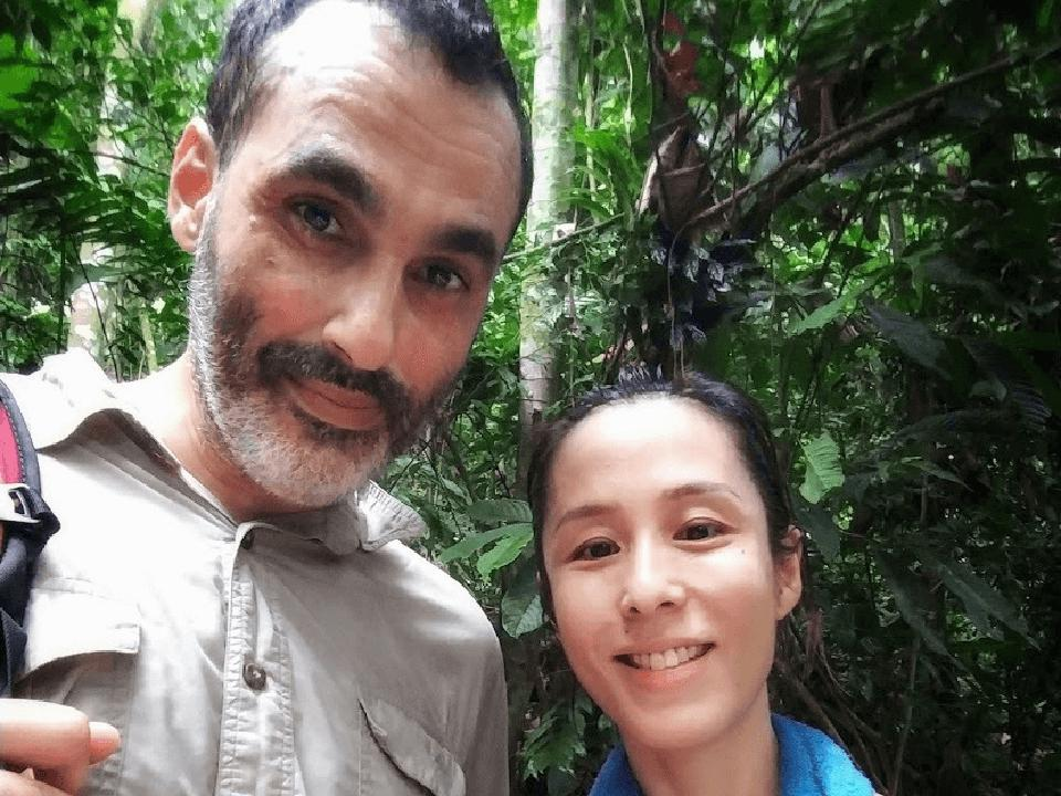 Selfie of Ati Bakush and Alison Lee in a rainforest hiking.