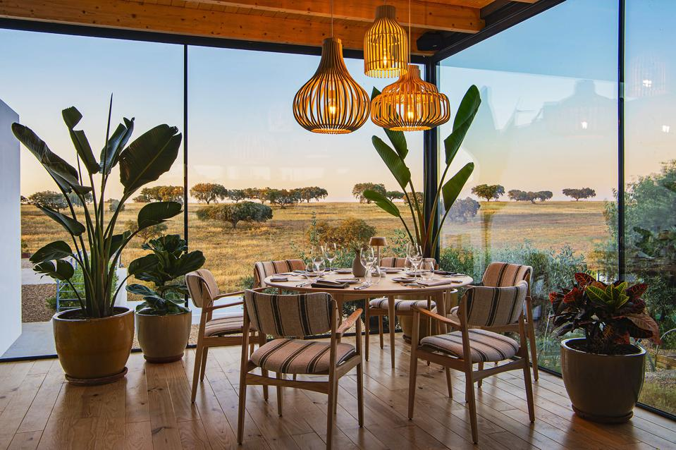 The dining room at Malhadinha Nova has beautiful views over the Alentejo countryside