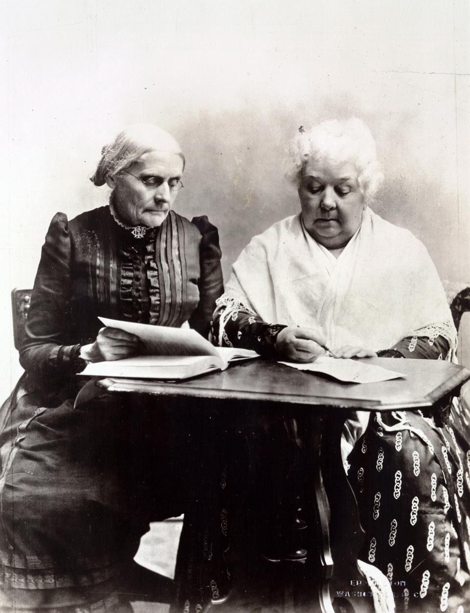 Susan B. Anthony and Elizabeth Cady Stanton in 1899, sitting at a desk