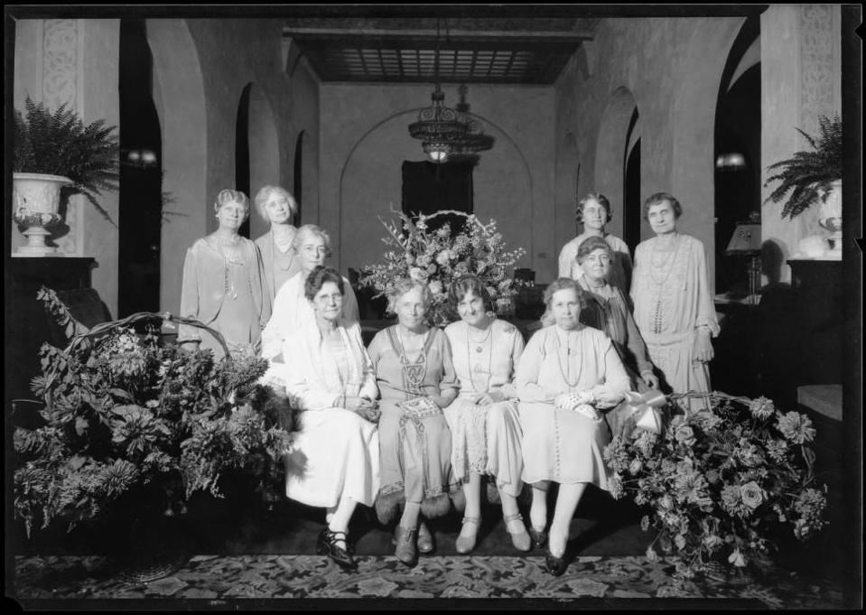 A group of women's rights activists meeting at the Hotel Figueroa, formerly one of the first female hostels in America.