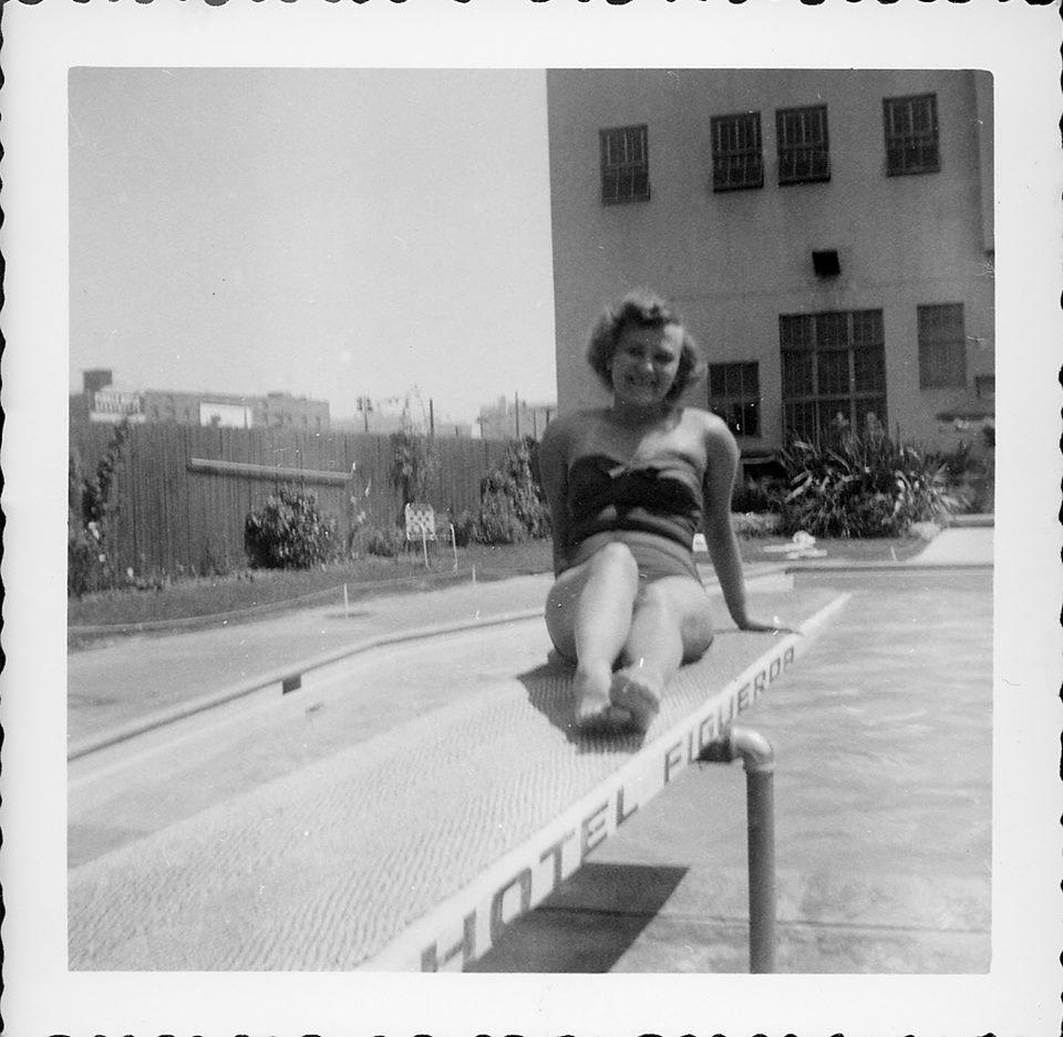 Woman in a bathing suit at Hotel Figueroa pool